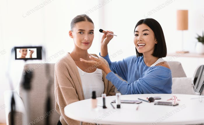 Asian Woman Doing Makeup For Her Model