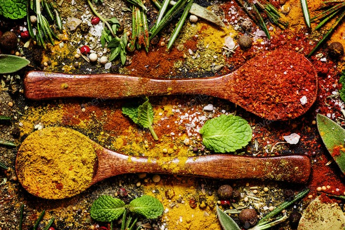Food background, spices, peppers, salt, herbs, mint leaves, top view