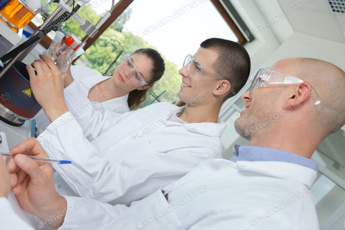 Science students performing experiment