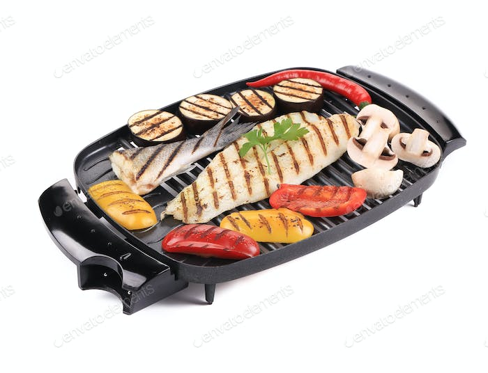 Grilled seabass on grill with vegetables