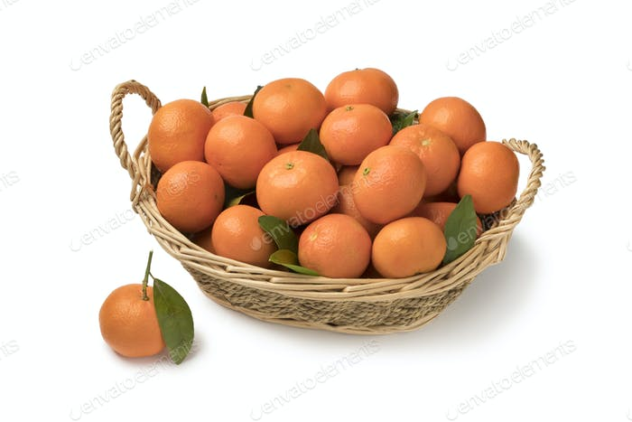 Basket with fresh mandarin fruit and leaves