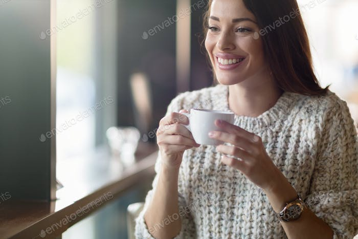 Beautiful woman drinking coffee