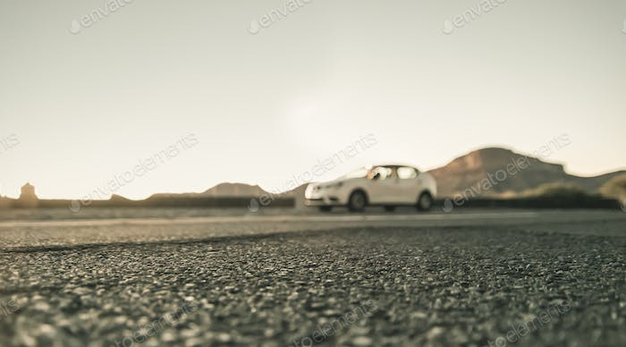 Blurred car traveling on road with beautiful mountain ridge landscape