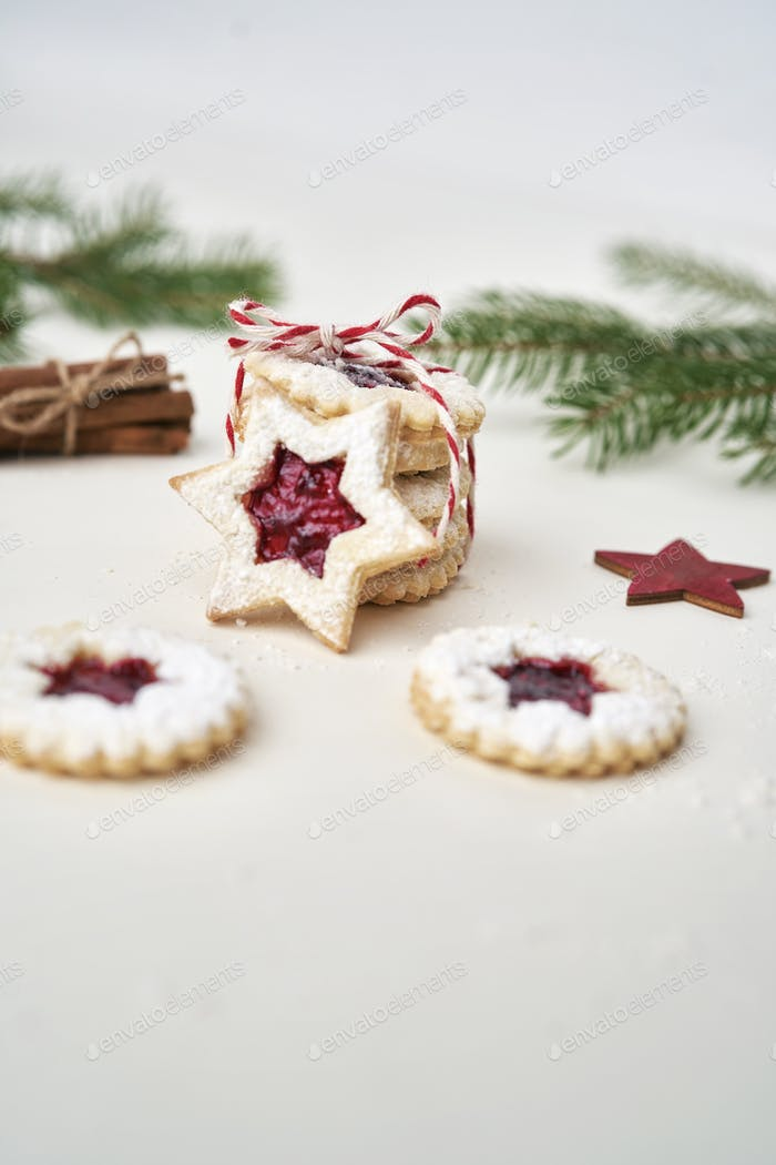 Stack of cookies with marmalade tied with Christmas rope