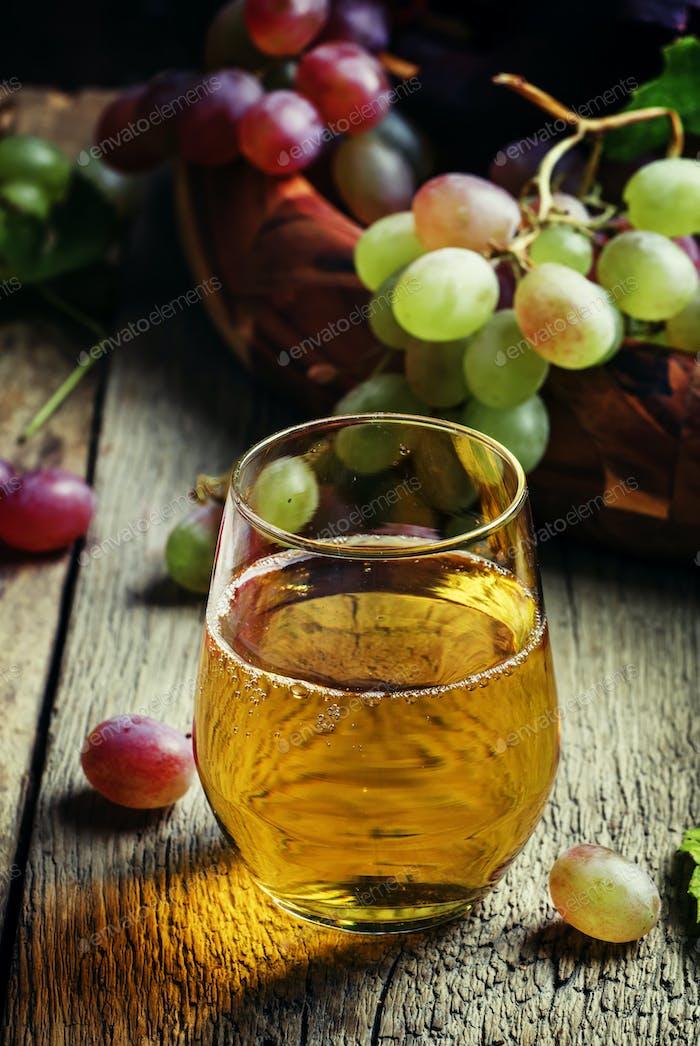 Light grape juice, still life in rustic style