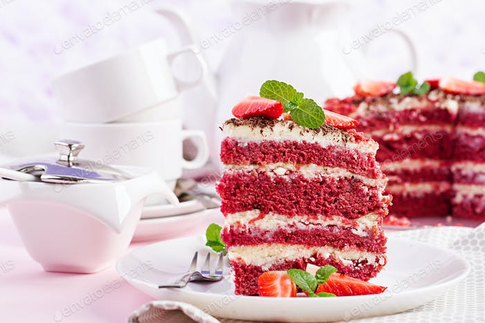 Red velvet cake on a pink background. Tea drinking. Table setting.