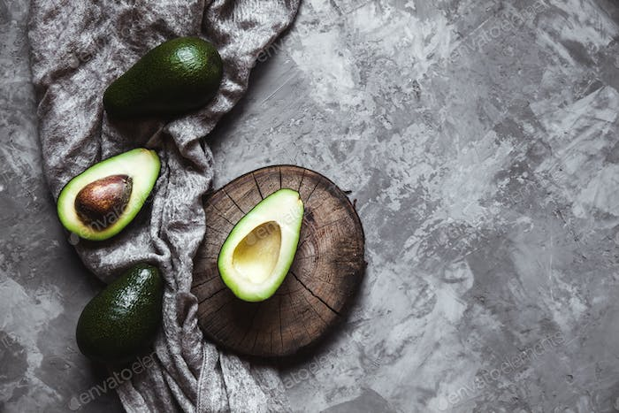 Avocado. Useful food on the table. Country style
