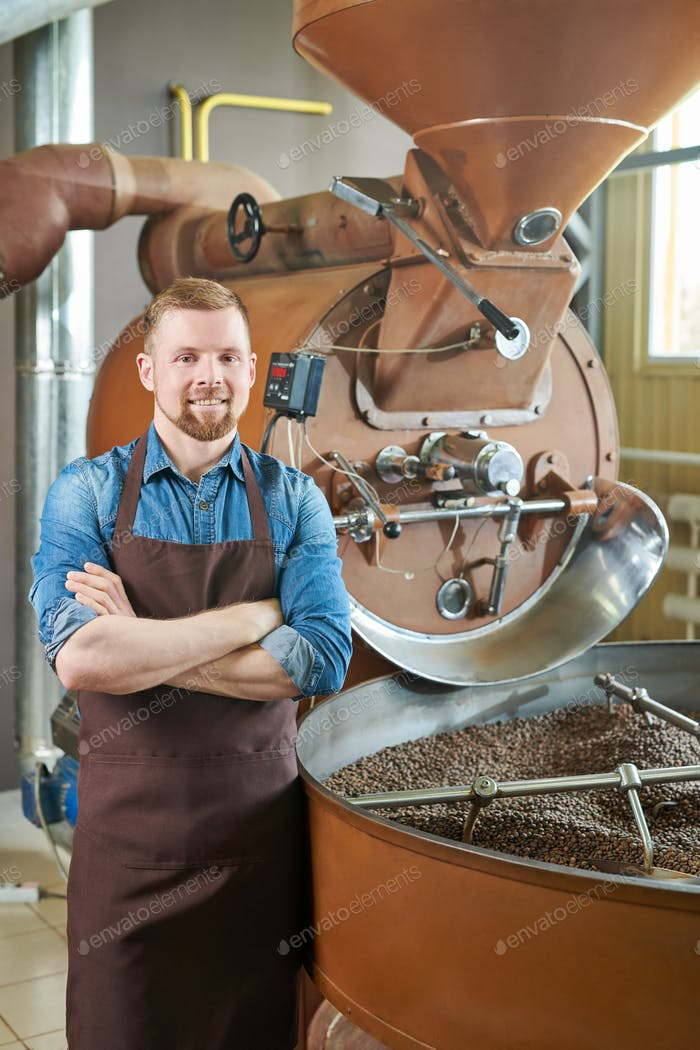 Modern Entrepreneur Posing in Coffee Roastery