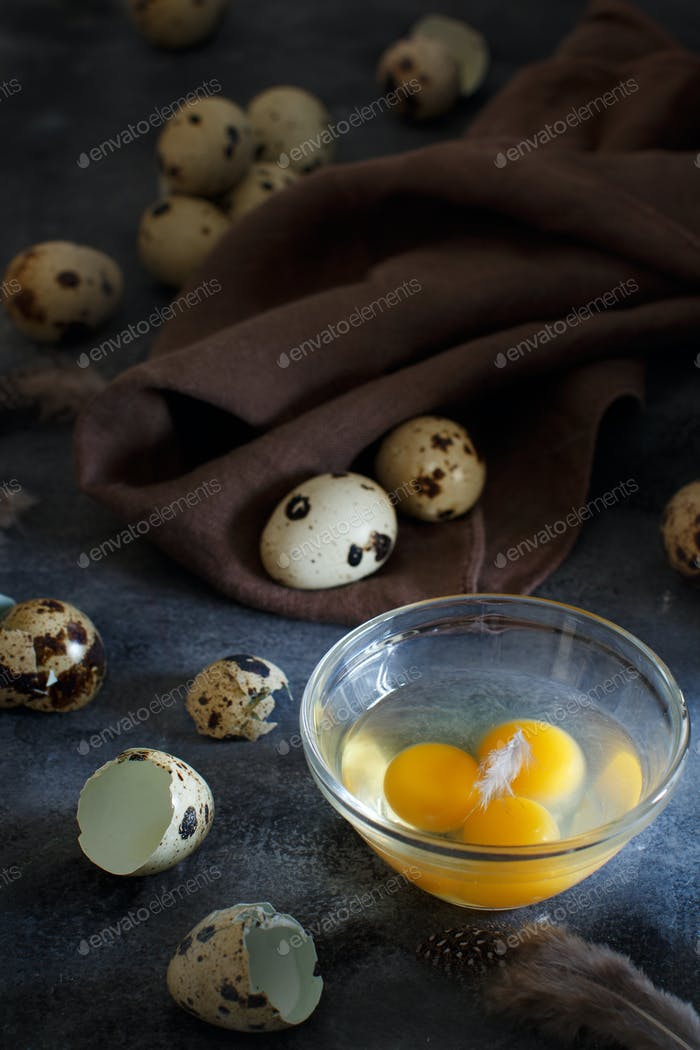 Quail eggs on a dark grey background