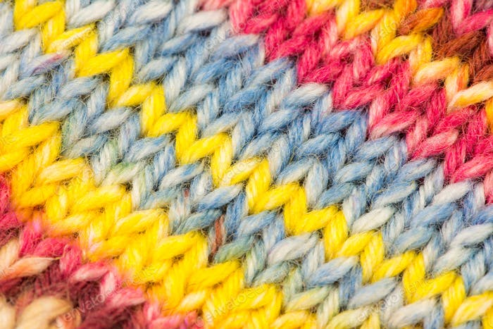 Knitted woolen multicolored background