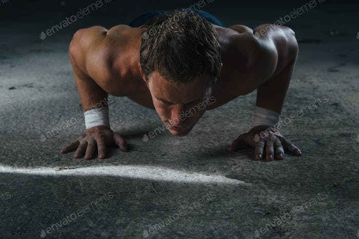 Muscle man doing push ups