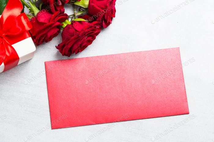 Holiday background with envelope, present and flower.