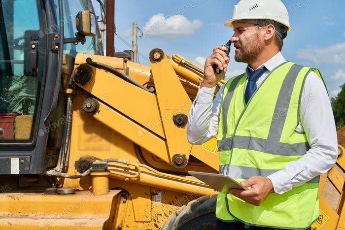Busy Construction Worker in Suit