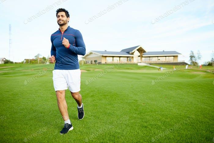 Jogging on green field
