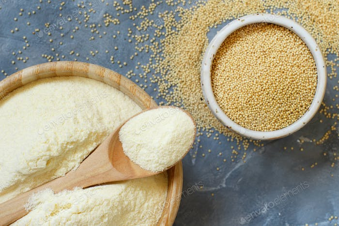 Bowl of raw Amaranth flour with a spoon and bowl of Amaranth seeds