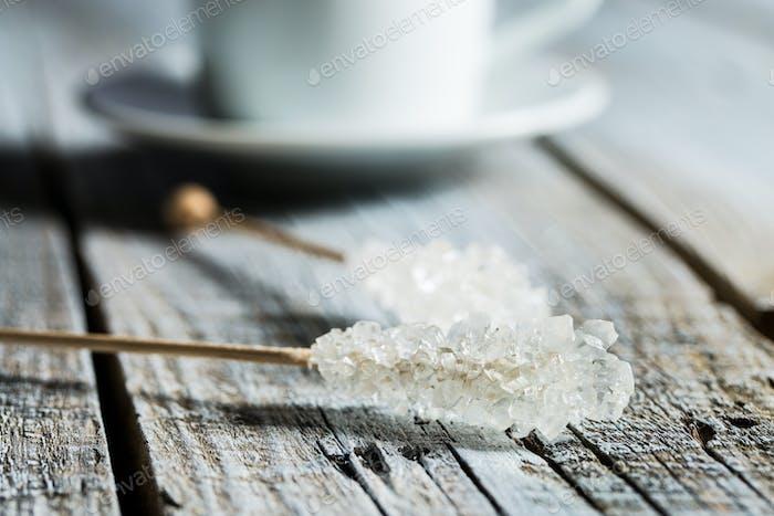Crystallized sugar on wooden stick.