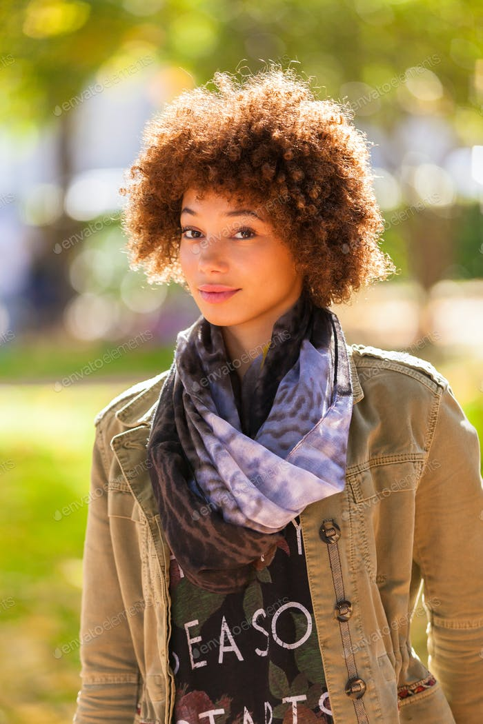Thumbnail for Autumn outdoor portrait of beautiful African American young woma