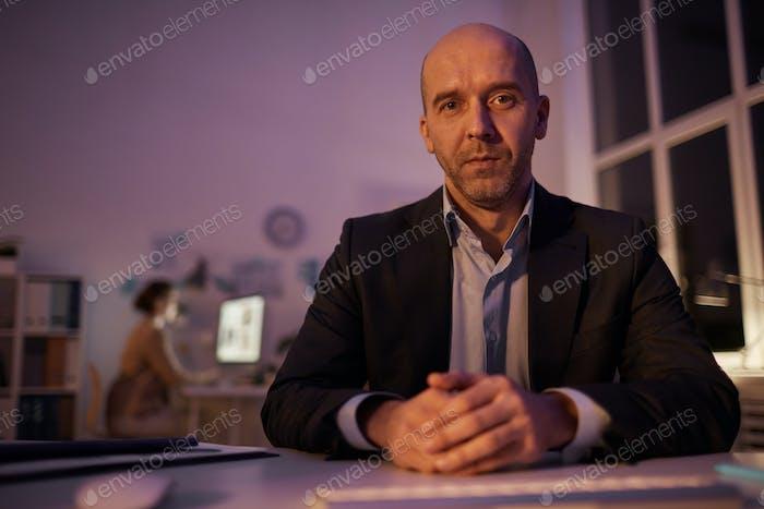 Mature Businessman Looking At Camera