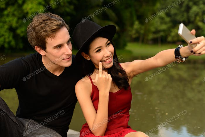 Portrait of multi ethnic couple together and in love at the park