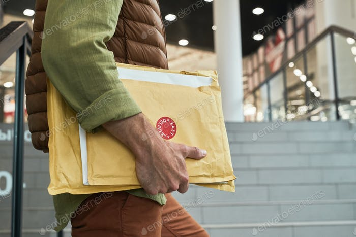 Delivery Man Holding Parcels Close Up