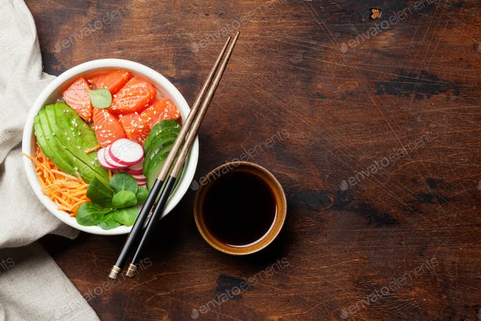 Poke bowl with salmon and vegetables.