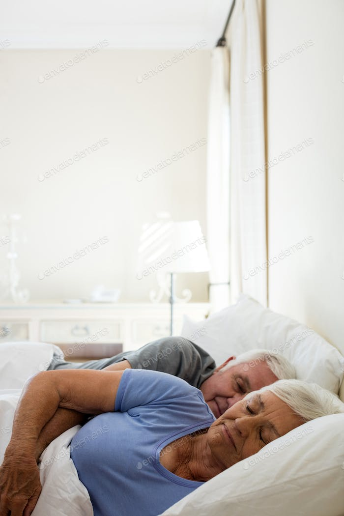 Senior couple sleeping in the bedroom