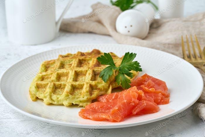 Zucchini waffles with salmon, fodmap diet side view closeup
