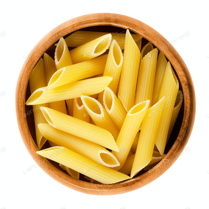 Penne rigate pasta in wooden bowl over white