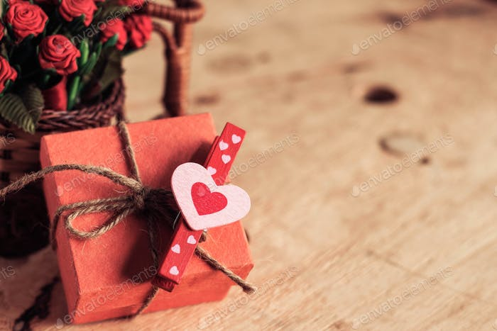 Heart-shaped and gift on wooden