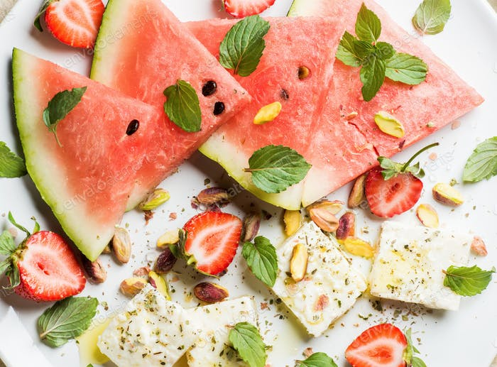 Summer watermelon, strawberry and feta cheese salad with pistachios