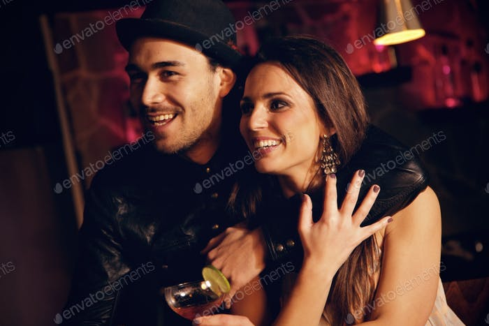 Cheerful Couple at the Club Having Fun