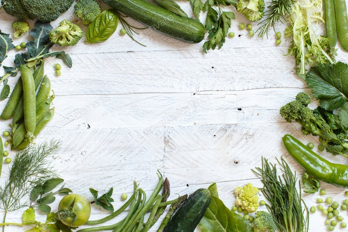 Green vegetables on a wooden table
