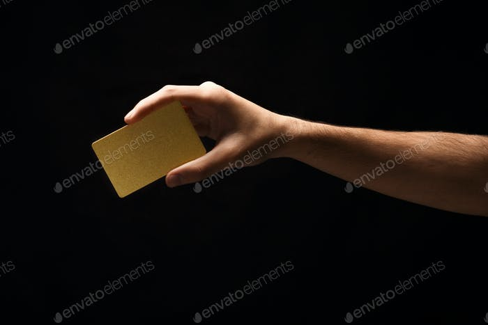 Closeup of male hand holding blank plastic card