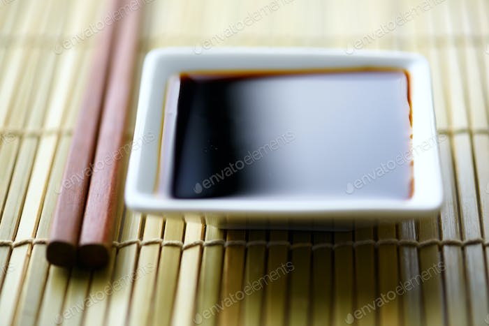 Soy sauce and wooden sticks