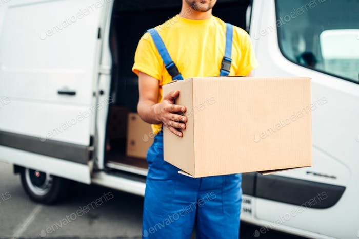 Male person in uniform holds cardboard box
