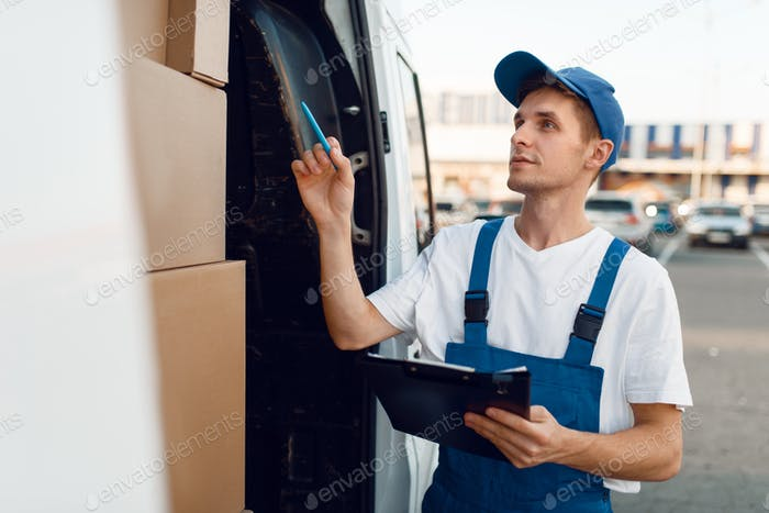 Deliveryman in uniform check boxes in the car