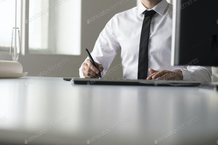 Front view of a businessman or photographer sketching and drawing