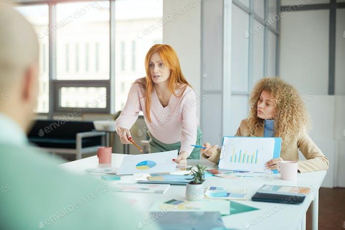 Persuasive Businesswoman in Meeting