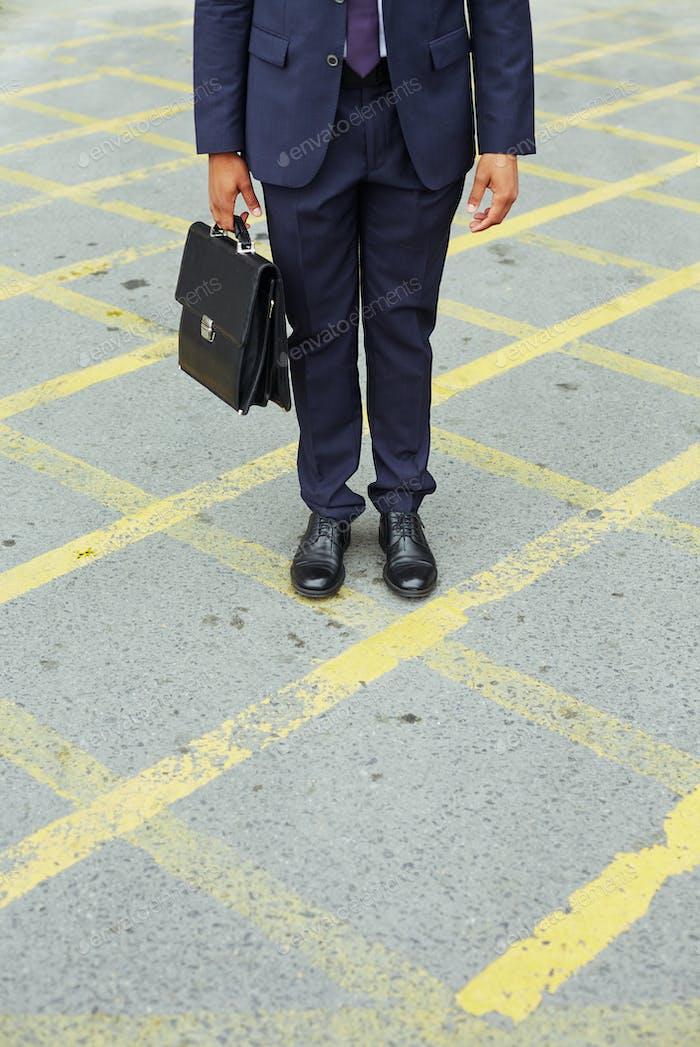 Businessman on asphalt