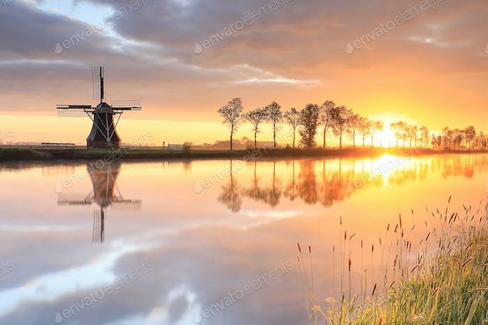Dutch windmill during beautiful sunrise