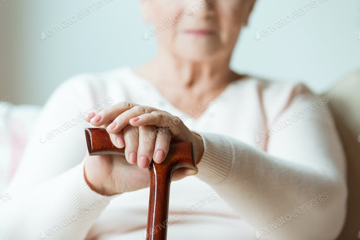 Elder holding walking cane