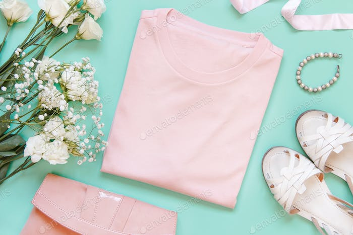 Place it - folded t-shirt surrounded by girly aaccessories and garments