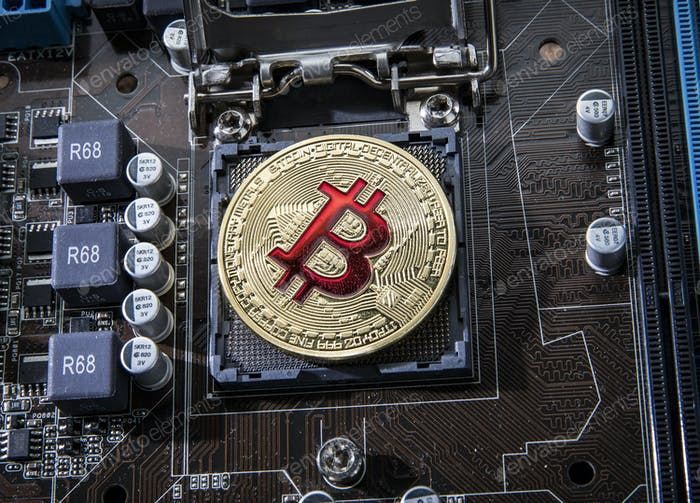 Gold Bit Coin BTC coins on the motherboard. Bitcoin is a worldwi
