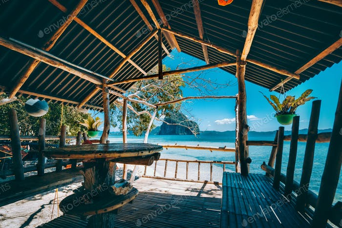 Tropical getaway remote panorama of impressive Pinagbuyutan island from the native wood and bamboo