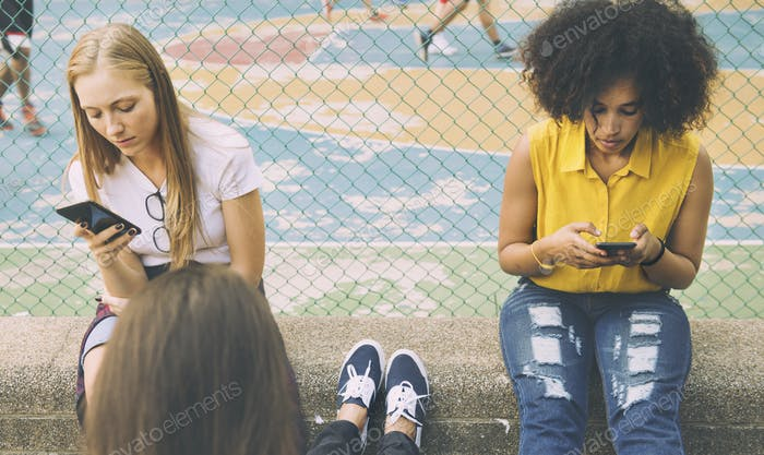 Friends in the park using smartphones