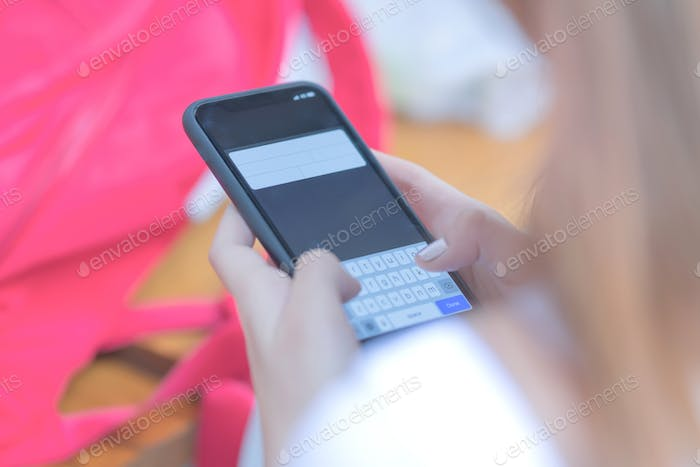 Young girls are using a smart phone.