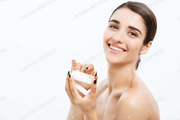 Beauty Youth Skin Care Concept - Beautiful Caucasian Woman Face Portrait smiling and holding cream