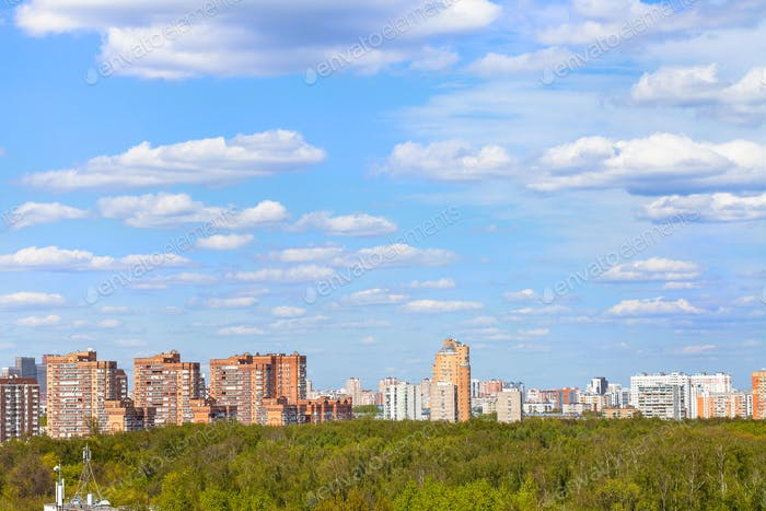 blue sky with clouds over city park in spring