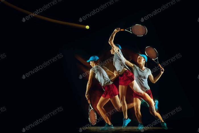 One caucasian woman playing tennis on black background in mixed light