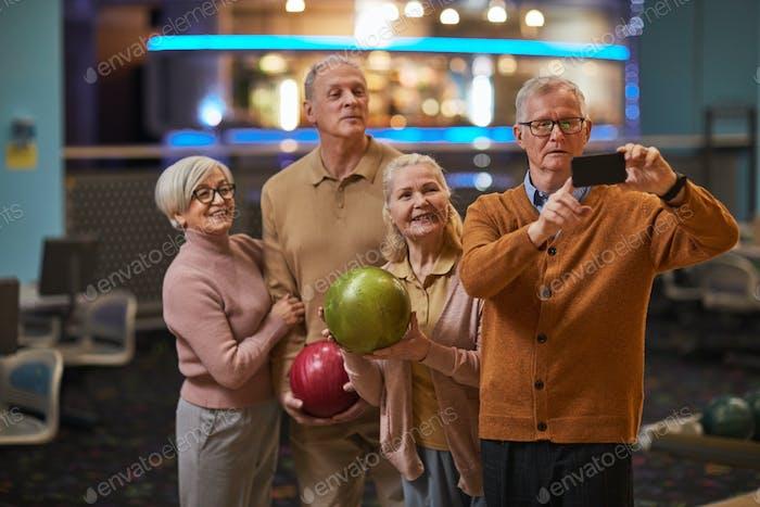 Senior People Taking Selfie Photos at Bowling